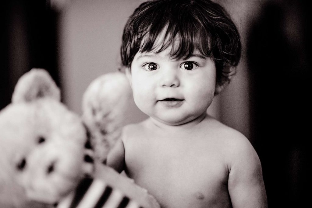 Toddler with stuffed toy teddy bear