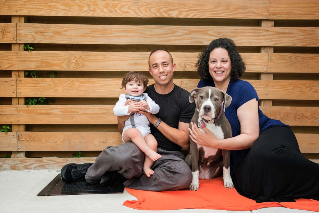 Family photo with parents, son and dog